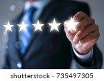 businessman pointing five star... | Shutterstock . vector #735497305