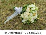 bridal bouquet on grass... | Shutterstock . vector #735501286