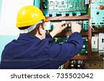 adult electrician builder... | Shutterstock . vector #735502042