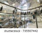 empty glass bottles on the... | Shutterstock . vector #735507442