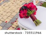 wedding bouquet on white chair. | Shutterstock . vector #735511966
