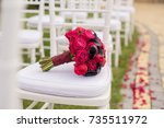 wedding bouquet on white chair. | Shutterstock . vector #735511972