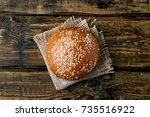 burger bun with sesame seeds on ... | Shutterstock . vector #735516922