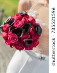 bouquet in the hands of bride. | Shutterstock . vector #735521596