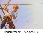 little girl climbing on an... | Shutterstock . vector #735526312