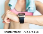 young fit woman using smart... | Shutterstock . vector #735576118