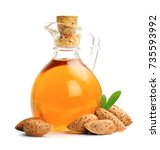 almonds nuts and almonds oil...   Shutterstock . vector #735593992