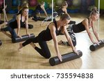 group of women doing exercises... | Shutterstock . vector #735594838