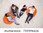 group of young multiethnic... | Shutterstock . vector #735596626