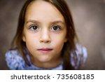 portrait of little girl looking ... | Shutterstock . vector #735608185