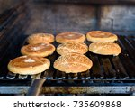 making and grilling hamburger... | Shutterstock . vector #735609868