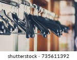 empty wardrobe stand with black ...   Shutterstock . vector #735611392