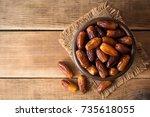dried dates fruit in ceramic... | Shutterstock . vector #735618055