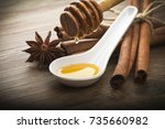 wooden honey dipper and spices... | Shutterstock . vector #735660982