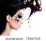 woman and face art with a lot of rhinestones on white background - stock photo
