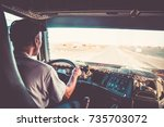 old male driver holding with... | Shutterstock . vector #735703072