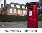 Red post box in London - stock photo