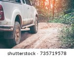 closeup offroad car at the... | Shutterstock . vector #735719578