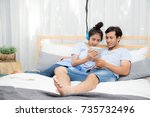 beautiful asian young couple... | Shutterstock . vector #735732496