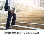 businessman holding computer... | Shutterstock . vector #735736636