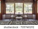 wood table top with blur room... | Shutterstock . vector #735760192