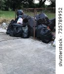 Small photo of Dirty black garbage bags in urban areas. The accumulated germs.