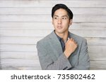 portrait of an asian businessman | Shutterstock . vector #735802462