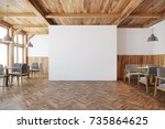 Stock photo bar interior with white and wooden walls square tables and a gray sofas a blank white wall in the 735864625