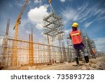 teamwork construction worker installation scaffolding in industrial construction by crane during sunset sky background over time job - stock photo