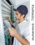 focused electrician applying...   Shutterstock . vector #735906916