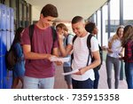 happy teenage boys sharing exam ... | Shutterstock . vector #735915358