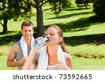 sporty couple in the park | Shutterstock . vector #73592665