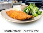 wiener schnitzel  veal cutlet... | Shutterstock . vector #735949492