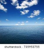 blue sea water surface on sky | Shutterstock . vector #735953755