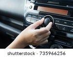 women turning button on car... | Shutterstock . vector #735966256