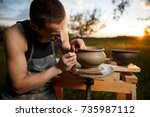 clay potter creating on the... | Shutterstock . vector #735987112