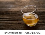 glass of whiskey with ice cubes ... | Shutterstock . vector #736015702