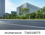 empty road with modern... | Shutterstock . vector #736018075