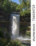 minnehaha waterfall in... | Shutterstock . vector #736034725