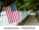 small american flag hangs from... | Shutterstock . vector #736035526