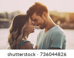 young happy couple enjoys... | Shutterstock . vector #736044826
