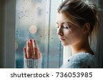 young girl looking out the... | Shutterstock . vector #736053985