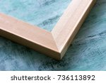 Small photo of The angle of the subframe on a blue background. Wooden stretcher bars.