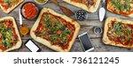 appetizing homemade pizza on a... | Shutterstock . vector #736121245