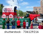 Small photo of NORMAN, OKLAHOMA - OCTOBER 13 2007: ACME road runner float marches on street in homecoming event