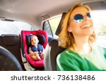 young mother with her little... | Shutterstock . vector #736138486
