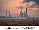 oil refinery at twilight | Shutterstock . vector #736139476