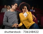 sad couple watching movie in... | Shutterstock . vector #736148422