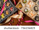 candy handmade in a gift box on ... | Shutterstock . vector #736156825