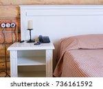 interior of a hotel bedroom   Shutterstock . vector #736161592